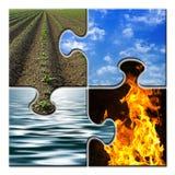 Quatre éléments dans un puzzle Image stock