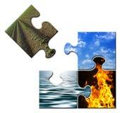 Quatre éléments dans un puzzle - la terre à part Photo stock