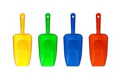 Quatre épuisettes transparentes en plastique colorées Photographie stock libre de droits