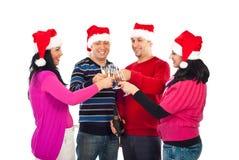 Quatre acclamations d'amis pour Noël Photographie stock libre de droits