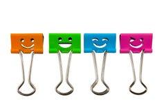 Quatre agrafe, visage de sourire Photos stock