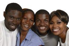 Quatre amis africains dans la joie Image libre de droits