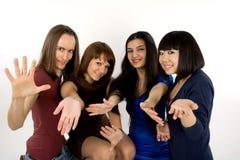 Quatre amis heureux Images stock