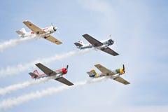 Quatre avions acrobatiques aériens de sport de vieux type Photographie stock libre de droits
