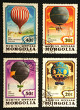 Quatre ballons de couleur sur des estampilles de Molgolia Photo libre de droits