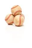 Quatre base-ball d'isolement sur le blanc r3fléchissant photographie stock