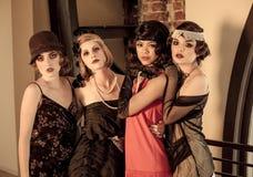 Quatre belles femmes de vintage Photographie stock