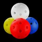 Quatre billes de floorball d'isolement Photos stock