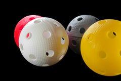 Quatre billes de floorball d'isolement Photographie stock