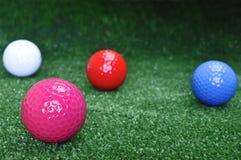 Quatre billes de golf image stock