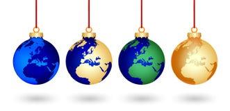 Quatre billes du monde de Noël Photos stock