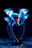 Quatre bleu martini avec la cerise Photographie stock libre de droits