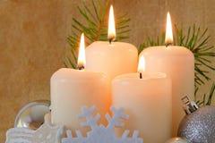 Quatre bougies d'arrivée. Photographie stock libre de droits