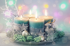Quatre bougies vertes de Noël Images libres de droits