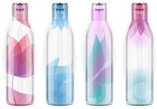 Quatre bouteilles en plastique avec la couleur franche Images libres de droits
