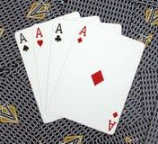 Quatre cartes de tisonnier d'as Images stock