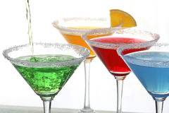 Quatre cocktails colorés Image stock