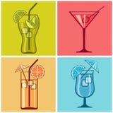 Quatre cocktails sur la couleur Photographie stock libre de droits