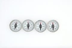 Quatre compas Photographie stock