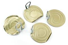 Quatre couvercles de boîte en fer blanc avec l'ouvreur Photos libres de droits