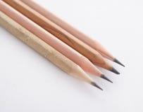 Quatre crayons en bois Photographie stock libre de droits