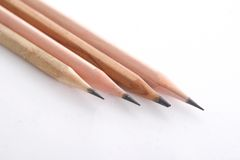Quatre crayons en bois Photo stock