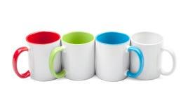 Quatre cuvettes colorées dans une ligne Images libres de droits