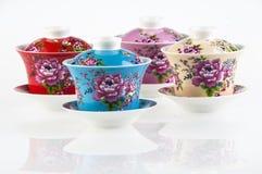 Quatre cuvettes de thé de porcelaine Image libre de droits