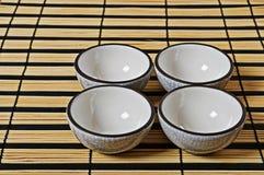 Quatre cuvettes pour le thé Images libres de droits