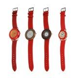 Quatre différentes montres rouges de type photo stock