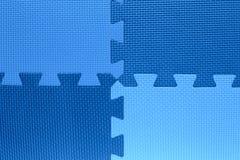 Quatre domaines de la couleur avec des morceaux de puzzle Photographie stock libre de droits
