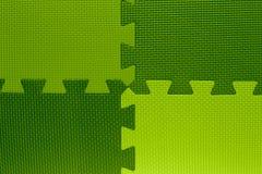Quatre domaines de la couleur avec des morceaux de puzzle Photos libres de droits