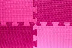 Quatre domaines de la couleur avec des morceaux de puzzle Photos stock