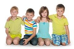 Quatre enfants gais Image libre de droits