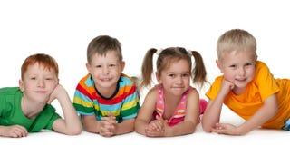 Quatre enfants heureux Photo libre de droits
