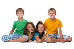 Quatre enfants heureux Photographie stock