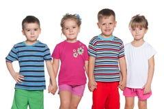 Quatre enfants joyeux Photo stock