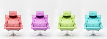 Quatre fauteuils multicolores Images libres de droits
