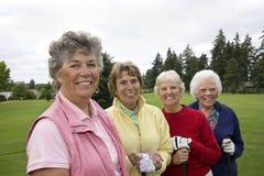 quatre golfeurs heureux photo libre de droits