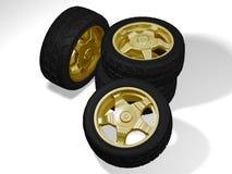 Quatre grandes roues d'or Photographie stock libre de droits