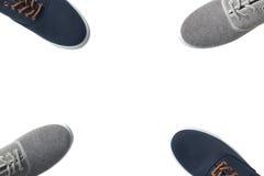 Quatre gris et espadrilles bleues d'isolement Photographie stock libre de droits