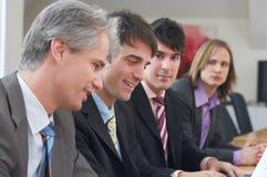 Quatre hommes au travail Image stock