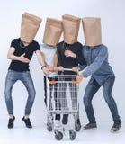Quatre hommes dans un concept d'achats sur le blanc photographie stock libre de droits