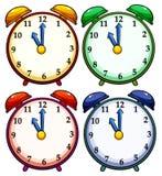 Quatre horloges colorées Photographie stock libre de droits