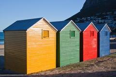 Quatre huttes de plage Photographie stock libre de droits
