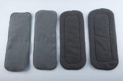 Quatre insertions de microfiber pour des couches-culottes de bébé Images stock