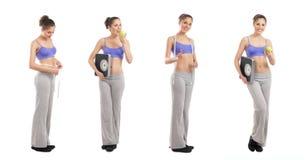 Quatre jeunes femmes dans des vêtements sportifs retenant des pommes image stock