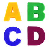 Quatre lettres écrites en plastique multicolore badine des lettres Photo libre de droits