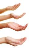 Quatre mains demandant une donation images libres de droits