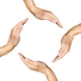 Quatre mains humaines effectuant une forme carrée sur le blanc Image libre de droits